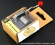 Musical mechanism in a corrugated cardboard box: hand crank musical mechanism with a red resin sphere - Item# for this hand crank musical mechanism : QUINQUIN