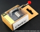 Musical mechanism in a corrugated cardboard box: hand crank musical mechanism with a red resin sphere - Item# for this hand crank musical mechanism : MAINTENANT