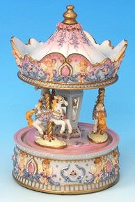 Miniature musical carousel made of resin with traditional 18 note musical mechanism - Item # for this miniature musical carousel : 14042