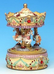 Miniature musical carousel made of resin with traditional 18 note musical mechanism - Item # for this miniature musical carousel : 14038