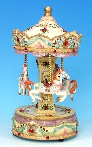 Miniature musical carousel made of resin with traditional 18 note musical mechanism - Item # for this miniature musical carousel : 14039