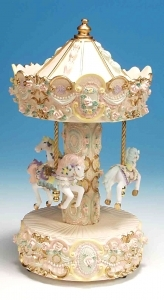 Miniature musical carousel made of polystone with traditional 18 note musical mechanism - Item # for this miniature musical carousel : 14059