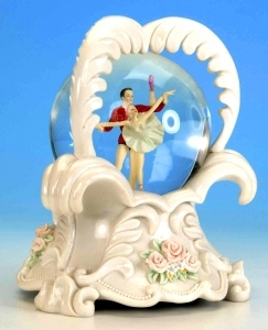 Musical snow globe made of resin with traditional 18 note spring musical mechanism - Item # for this musical snow globe : 25080