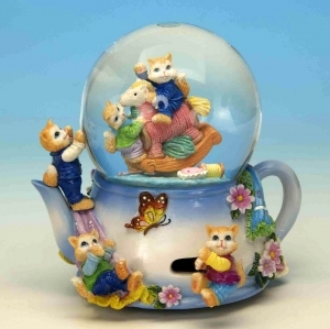 Musical snow globe made of resin with traditional 18 note spring musical mechanism - Item # for this musical snow globe : 14102