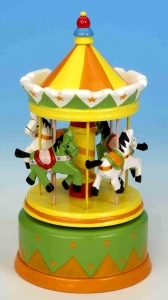 Miniature musical carousel made of wood with traditional 18 note musical mechanism - Item # for this miniature musical carousel : 43740