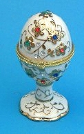 Fabergé style musical egg with traditional 18 note musical mechanism inserted in the lid - Item# for this Fabergé style musical egg : 43235