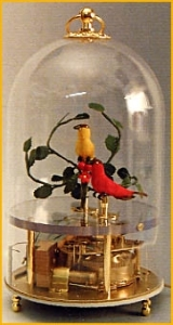 Mechanical singing birds automatons in a transparent cage made of plexiglass for showing the complex mechanism of the singing bird automatons (golden finish) - Item# for these mechanical singing birds automatons : OC-102