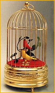 Mechanical singing birds automatons in a golden cage made of metal - Item# for these mechanical singing birds automatons : OC-104