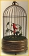 Mechanical singing bird automaton in an antique cage made of metal - Item# for this mechanical singing bird automaton : OC-106