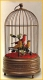 Mechanical singing birds automatons in an antique cage made of metal - Item# for these mechanical singing birds automatons : OC-108
