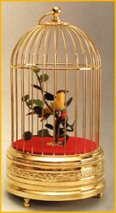 Mechanical singing bird automaton in a golden cage made of metal - Item# for this mechanical singing bird automaton : OC-103