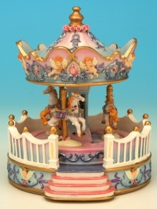 Miniature musical carousel made of polystone with traditional 18 note musical mechanism - Item # for this miniature musical carousel : 14111