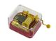 High quality hand cranked music box : golden hand cranked music box made of resin with a yellow handle.