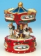 Christmas miniature musical carousel made of resin with traditional 18 note musical mechanism - Item # for this Christmas miniature musical carousel: 47009