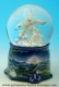 Musical snow globe made of resin and glass: musical snow globe with white winged horses.
