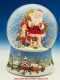 Christmas musical snow globe made of polystone : Santa Claus and Christmas presents.