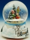 Christmas musical snow globe made of polystone : Decoration scene with a Christmas tree.