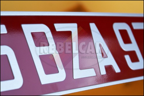 Red stamped car plate 52x11 cm with classic silver digits