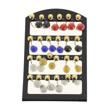 Assortiment boucles oreilles balancier double boule