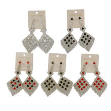 Assortiment boucles d'oreille losange sertie strass brillants