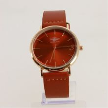 Montre cadran rond en or rose sur bracelet simili cuir terracotta
