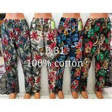 Pantalon coupe ample doté d'un imprimé floral tropical