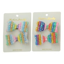 Barrette noeud recouverte de paillettes multicolores