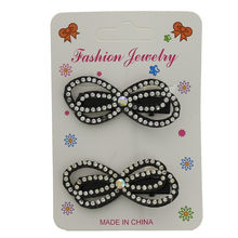 Assortiment barrette nœud parsemée de strass brillant